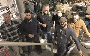 Matt Vivatson of Eel River Brewing, Thomas Carter of Humboldt Bay Coffee, Ted Vivatson and Michael Smith of Eel River Brewing, Adam Dick and Dustin Taylor of Dick Taylor Craft Chocolates gathered at Eel River Brewing's Scotia Brewing Facility to produce Single Origin Mocha Stout